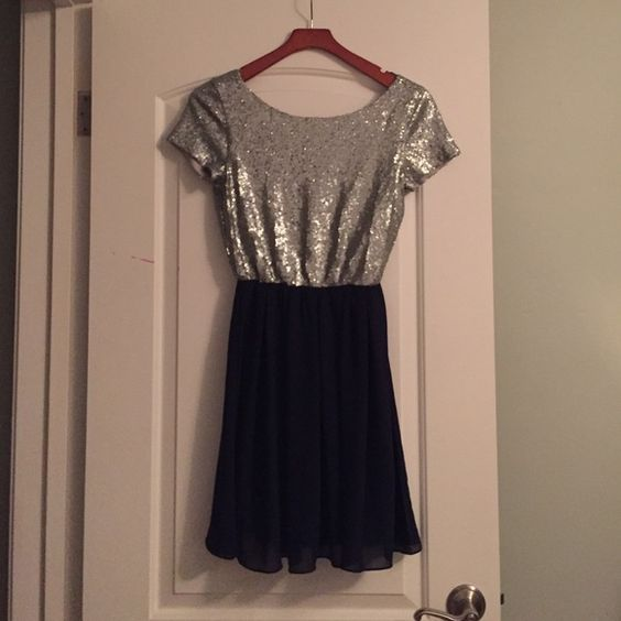 Navy and grey dress. Navy chiffon bottom with grey sequin top. Modest. Never worn. Purchased from Francesca's. Buttons Dresses Midi