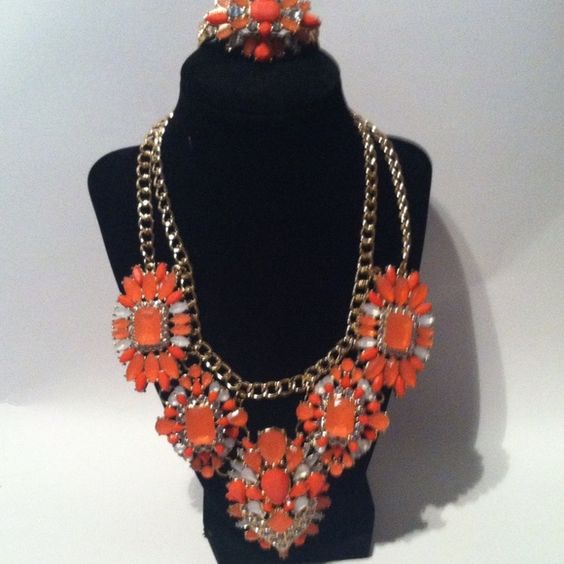 Statement necklace & bracelet orange rhinestones Brand new statement necklace and bracelet Jewelry Bracelets