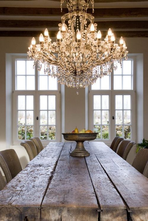 rough farmhouse table, crystal chandelier. Not this exact thing but just an example of mixing old farm with modern/dressier style.: