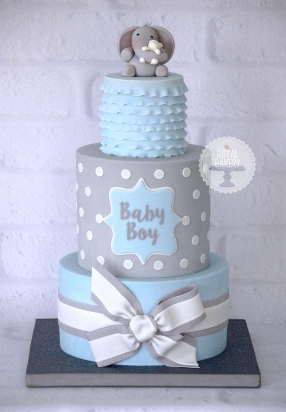 A baby boy blue and grey baby shower cake based on a design by Cake Me Away Cakery: