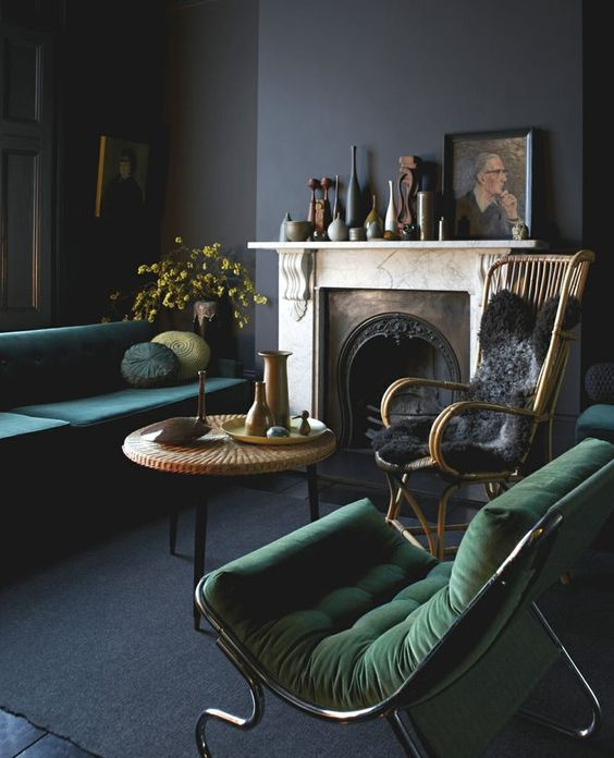 black walls and emerald green sofas: