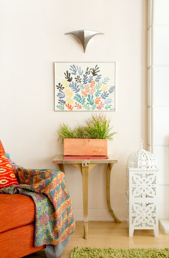 Matisse Print, terracotta pots with succulents, kantha quilt, Ikat cushion {Photo by Jessica Comingore, Design by Justina Blakeney}