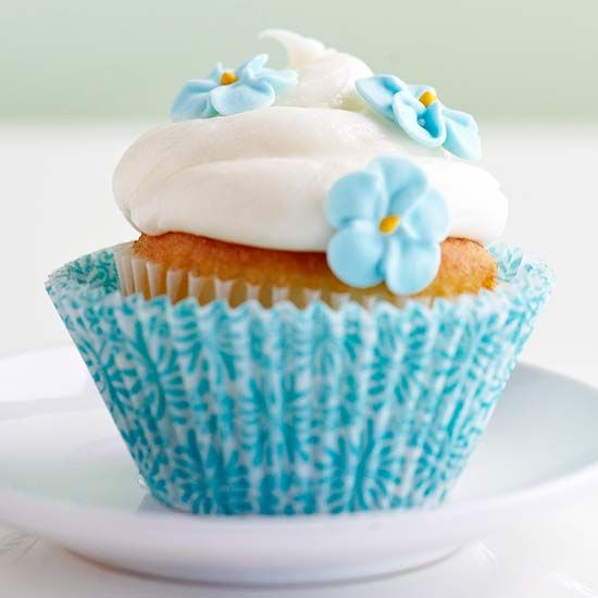 These cute Flower Swirl Cupcakes always go over well. Learn how they're made: http://www.bhg.com/party/birthday/cake/birthday-cakes-and-cupcakes-for-girls/#page=27