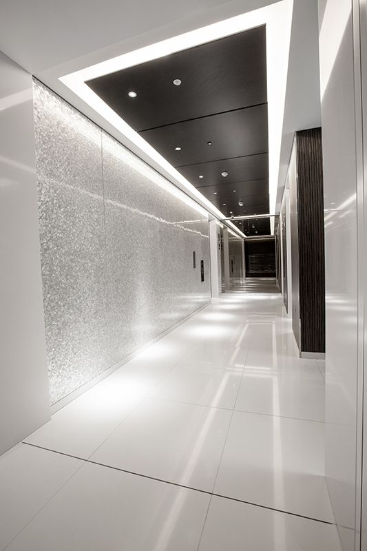 elevator lobby with mother of pear accent wall from shellshock design accent office interiors accent office interiors