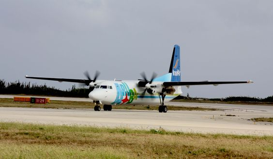 Insel Air Aruba Fokker 50 taxiing to gate at Hato International Airport