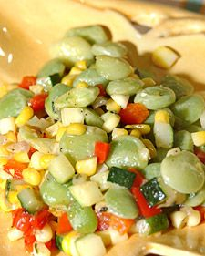 "First created by Native Americans, this savory dish of corn, peppers, zucchini, and lima beans is still a favorite in the U.S. South. The name ""succotash"" is derived from the Naragansett Indian word ""msickquatash,"" meaning ""boiled whole ear of corn.""  Succotash is hearty enough to be served as an entree, but also makes a wonderful accompaniment to fried chicken or grilled pork chops."