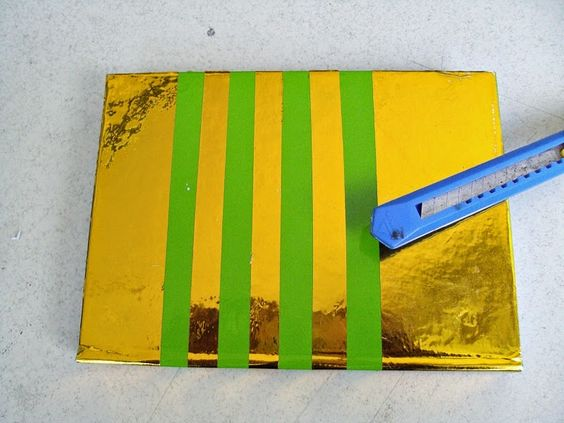 green notebook, gold stripes