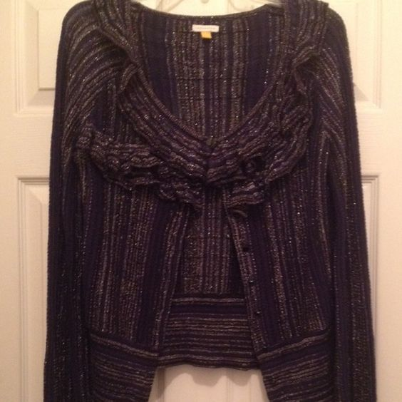 Like new Metallic blue cardigan from Leifsdottir Metallic blue ruffle cardigan by Leifsdottir. Pretty delicate but like new, absolutely no wear. Size medium but could work for a large with smaller shoulders. Anthropologie Sweaters Cardigans