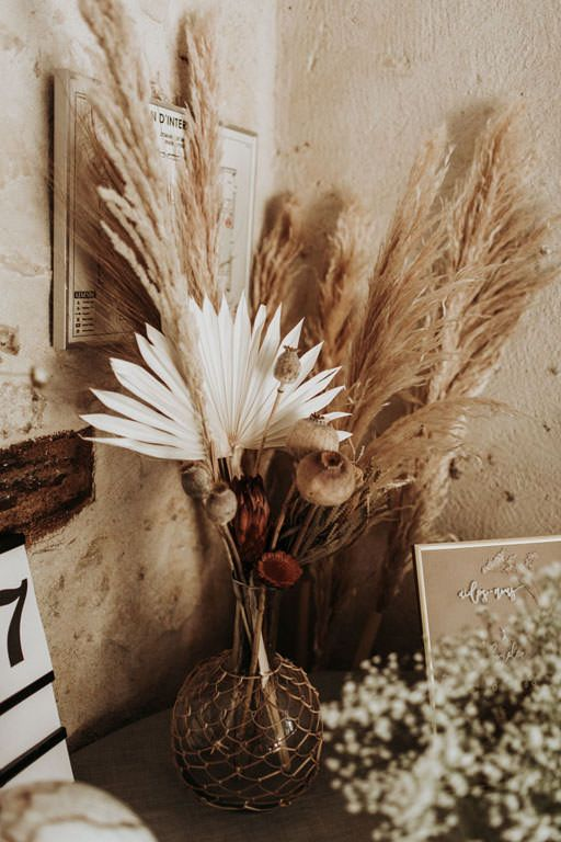 Dried flower arrangement with pampas grass at a wedding