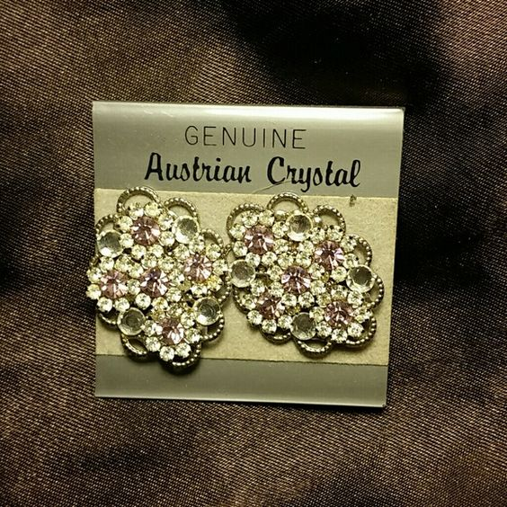Austrian crystal earrings Austrian crystal clip on earrings. The colored stones are a pink or light purple color. Beautiful earrings. Great for formal wear accessory piece. Jewelry Earrings
