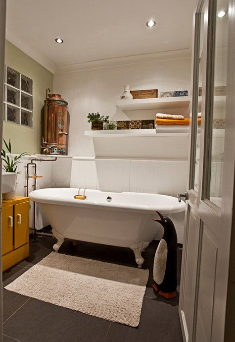 love this simple small bath with on demand heater (I think), sleek wall shelves and hot yellow cupboard.