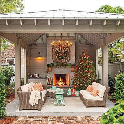 Bring the holidays outside glowing outdoor fireplace for Brick garden room designs