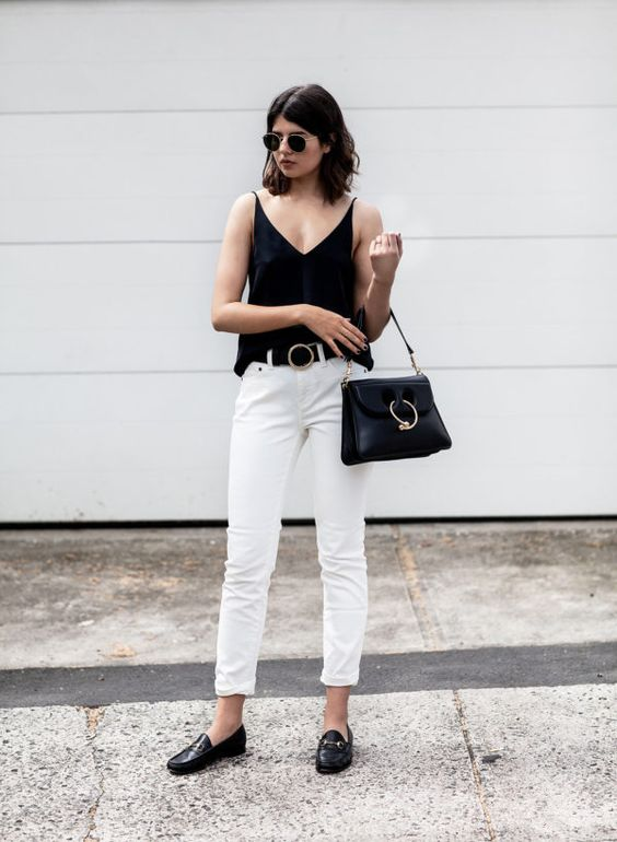 Talisa Sutton pairs these black leather loafers with white jeans and a black tank top for a gorgeously contrasting outfit which is sure to give you a sophisticated style. Loafers are also especially effective worn with cropped or rolled jeans! Camisole/Jeans: Grana, Bag: J.W Anderson, Loafers: Gucci.: