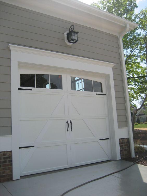 !!Add trim to garage door!!Add hardware to you boring garage door to give it a quick update.