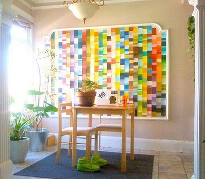 Can you get paint chips for free or for really cheap? If so, this is a cost-effective wall art project that will give a huge punch of color to your wall.