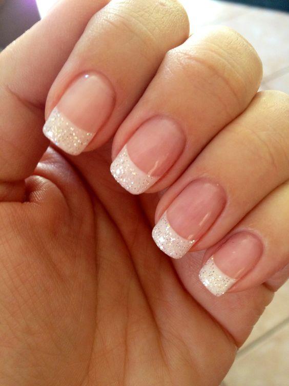 Use iridescent white glitter. White tips fully dipped in glitter. Round tips. Longer rather than shorter length. Small white heart on pink part of nail on wedding finger.