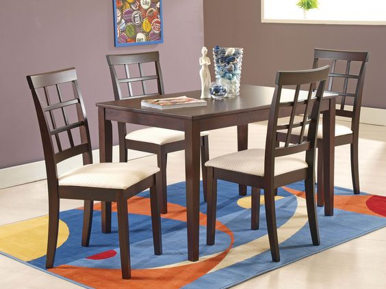 TEXAS DINING SET - A compact solid wood dining table and 4 high-back chairs. The Texas's simple understated style highlights the wood grain, and fits into any style of décor; 4 seater; PRICE : Rs. 25,520/-; Buy now: http://tfrhome.com/landing/productlandingpage.php?product_code=ds-08