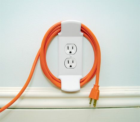 Wall Cleat takes care of all the cords and wires that have cluttered up our lives.: