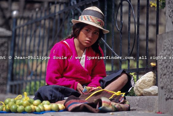 Few children attend school in Bolivia. Boys work in the fields or mines while girls help support the family by selling produce in the street of large cities. This girl hopes to make a few cents selling oranges...La Paz, Bolivia
