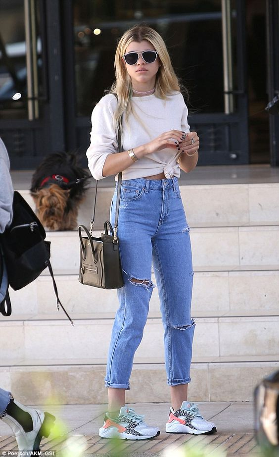 Sofia Richie flashes midriff in knotted sweater and high-waisted jeans: