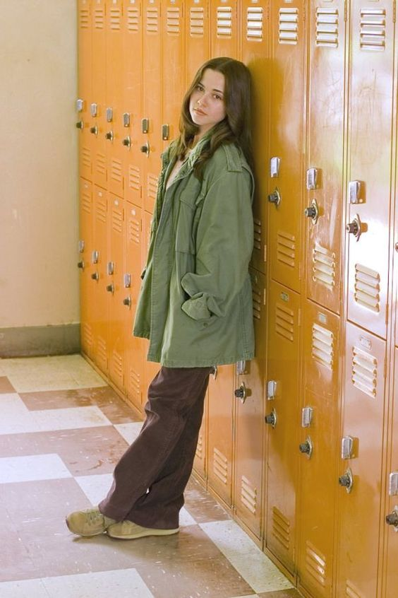 Lindsey Weir- Freaks and Geeks. 90's style. Big military jacket over striped shirt and boot cut pants.