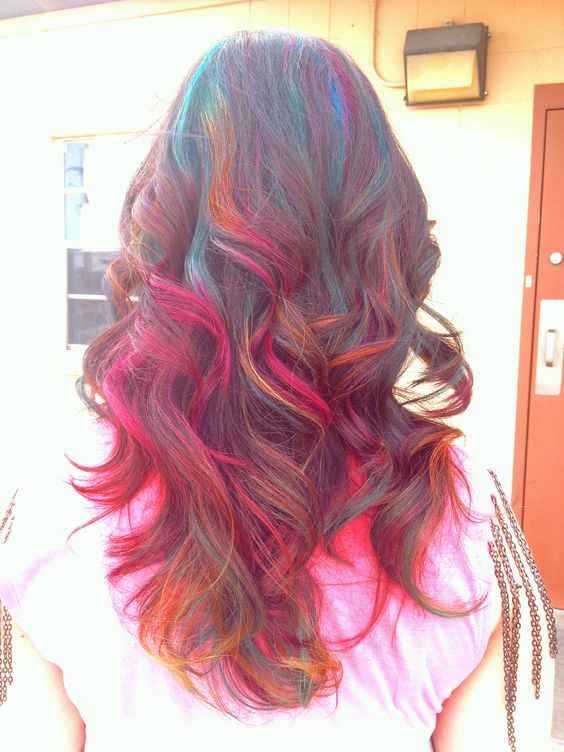 I LOVE my new rainbow highlights! My stylist used teal, pink, blue and orange permanent highlights on dark long hair.