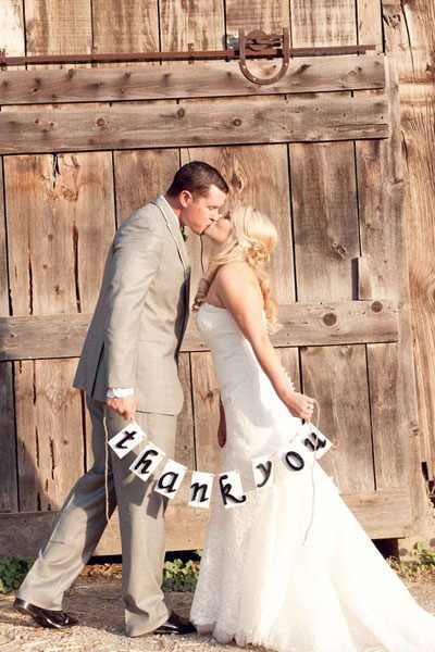 """Make it easier to find the perfect photo for your thank-you cards by planning a picture specifically for that purpose! Why You Love It:""""I love this! Great idea for thank you cards!""""—Linda B. """"So cute! The background, the sign, the couple...""""—Advantage Bridal Photo Credit: Stephanie Moe Photography"""