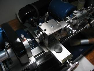 Riser or spacer block can be made to bring the height of the dividing head up to Cowell lathe centers