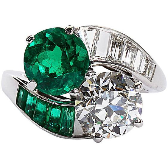 Colombian Emerald Diamond Bypass Ring | From a unique collection of vintage engagement rings at https://www.1stdibs.com/jewelry/rings/engagement-rings/