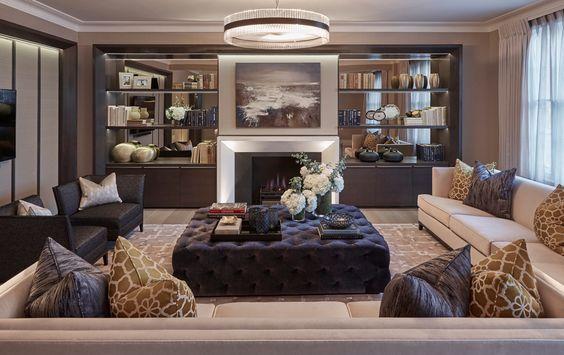 Beautiful apartment by London interior designer Laura Hammett. Wacky, giraffe-esque cushions mixed with deep purple, really fun combination: