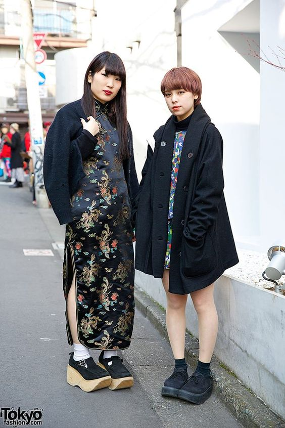 Natsuko & Ai are two 19-year-old beauty school students who we met on the street in Harajuku. Natsuko is wearing a cheongsam with a jacket & Hug Harajuku platforms. Ai is wearing a Y's coat over a matching top & skirt with Tokyo Bopper platforms.