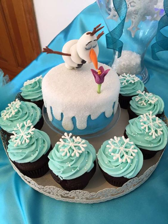 Frozen birthday party Olaf mini cake and cupcakes! See more party planning ideas at CatchMyParty.com!