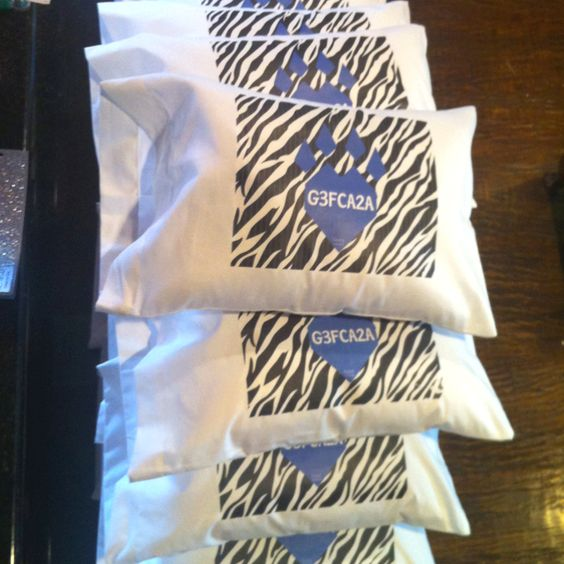 Team motto Ironed on to travel size pillow cases with pillows. Easy inexpensive team gift.
