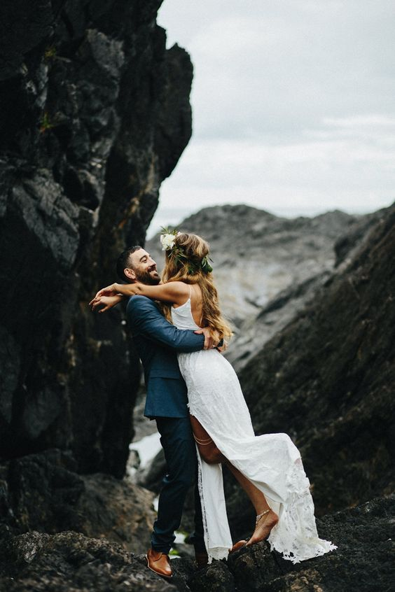 Moody, romantic vibes for this cliffside barefoot beach wedding   image by Scott Little Photography