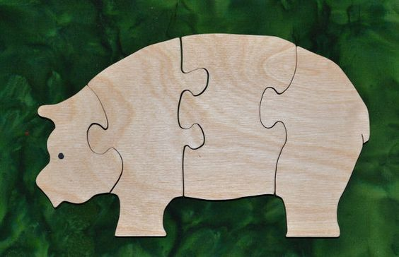 """This Pig Puzzle is fun to do and assists in the development of small motor, hand-eye coordination, visualization and problem solving skills all of which are important in the process of reading.    Our puzzles are made from toy quality 1/2"""" Baltic birch plywood and are rubbed with AFM Naturals, an oil wax finish that is completely safe. Dimensions: 5"""" high, 8.5"""" long"""