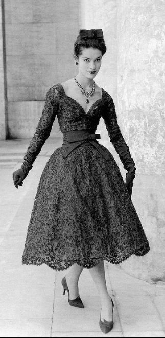 Kouka Denis in two-piece guipure lace dress by Yves Saint Laurent for Dior, 1958