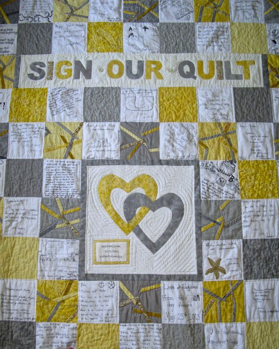 Close up of wedding guest book quilt for my son and daughter in law.  Guests signed 6 x 6 inch white squares at wedding; assembly of quilt was done later.