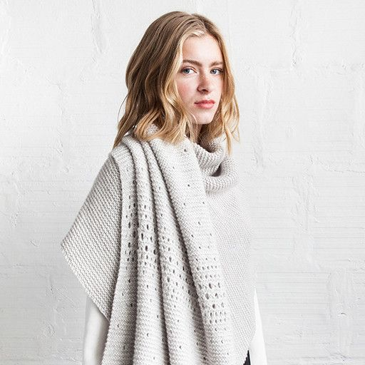 Minimal simplicity at its best. This epically scaled wrap is articulated with a delicate sprinkling of gradually populated eyelets in its garter stitch fabric. A lavish, dense knit is created by working together a strand of Får with Sno.