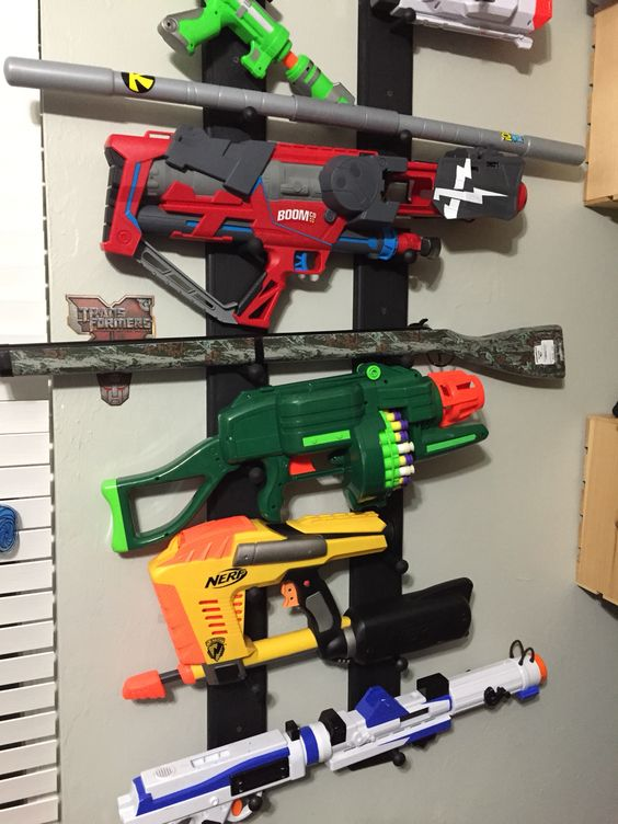 Used a wooden hanger and turned them vertical after painting them black. Worked well to hang all the toy nerf guns etc...