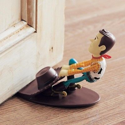 Avoid doors shutting with this fun little Woody from Disney Japan