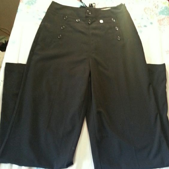 "Forever 21 Sailor pants Awesome black slacks that have fixed buttons in the front and fixed tie up in the back Zipper on the side for entrance   Polyester/rayon/spandex blend. 34"" inseam. Gently worn and in great condition !! Forever 21 Pants"