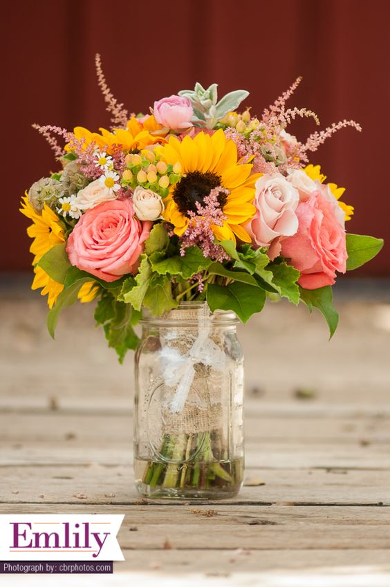Sunflower and coral roses bridal bouquet