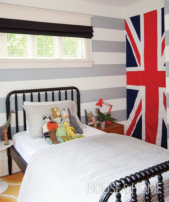 The Union Jack was a lucky eBay find that fits into an awkward nook, while the spool bed keeps things charming. | Photographer:  Janis Nicolay  Designer:  Nancy Riesco