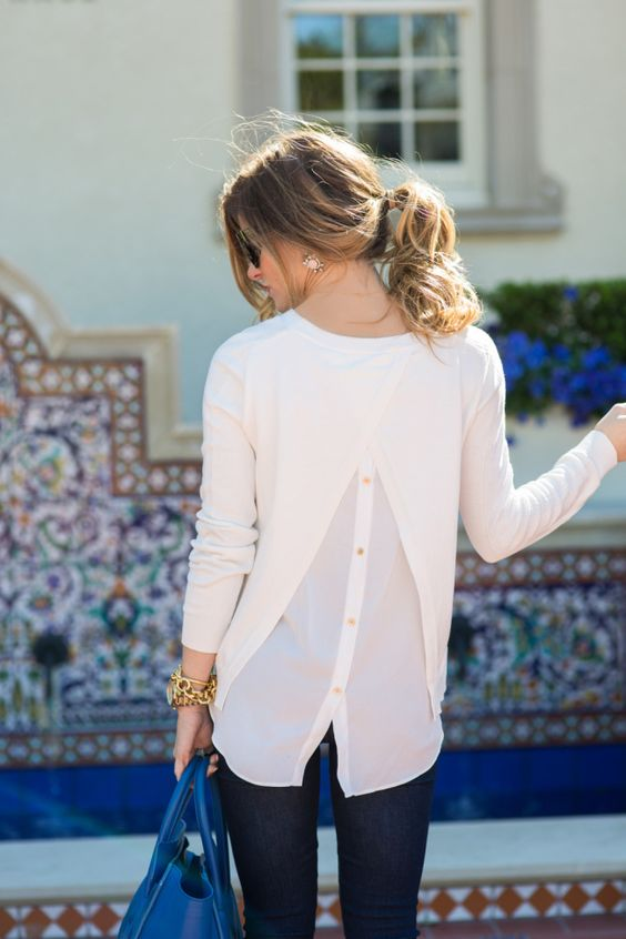 white split back sweater + dark blue skinny jeans + blue celine