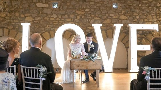 Giant 'LOVE' light up letters | Wedding film by http://www.silversixpencefilms.com/