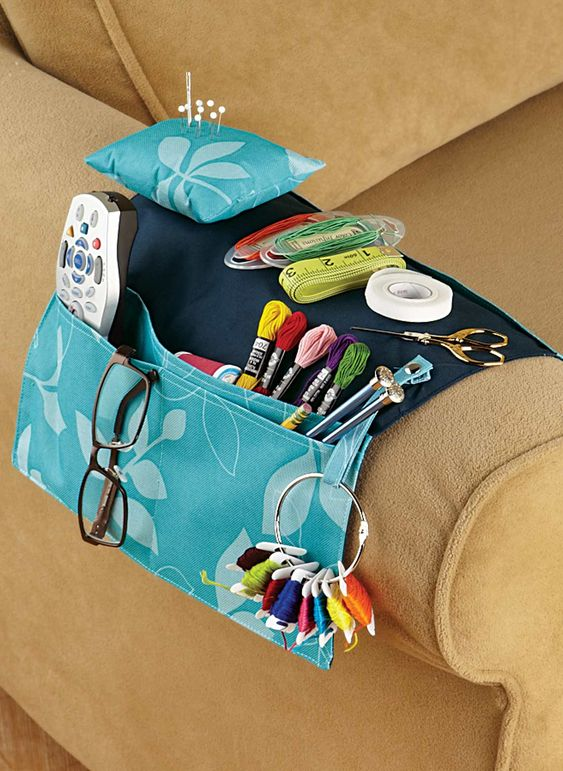 Nifty organizer has multiple pockets. Fits over the arm of your chair or sofa to hold all your crafting needs, plus other accessories. Includes removable pin cushion and snap holder for scissors and bobbins. Polyester. Gentle wash. 20&34;L x 12&34;W.