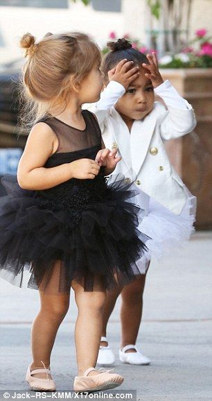 Dancing duo: The tots made for quite an adorable sight in their matching outfits and tiny ...