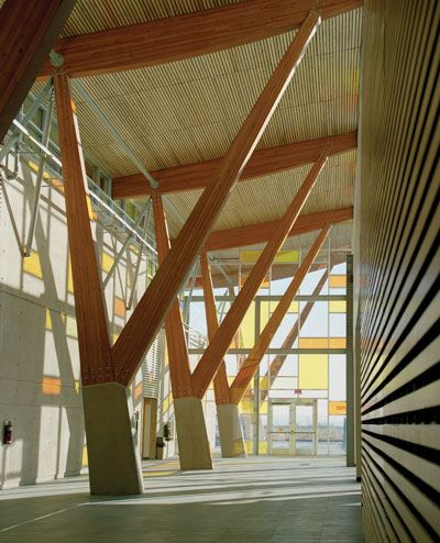 """Dramatic wood """"trees"""" line the concourse of Kwantlen Polytechnic University's Cloverdale campus."""