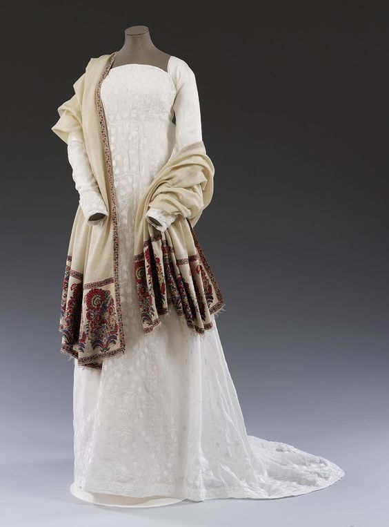 1805-1810 ca. Muslin Dress. Dress, cotton embroidered with cotton thread, woven in Bengal. Given by Miss. P. H. Rew. Museum no. CIRC. 30-1958. 1750-60 ca. Shawl, twill-tapestry woven pashmina, Kashmir. Given by Miss M. Davis. Museum no. IM. 17-1915 © Victoria and Albert Museum, London collections.vam.ac.uk