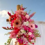 Fresh Floral Sprays accent the natural sweetwater Bamboo wedding arbor